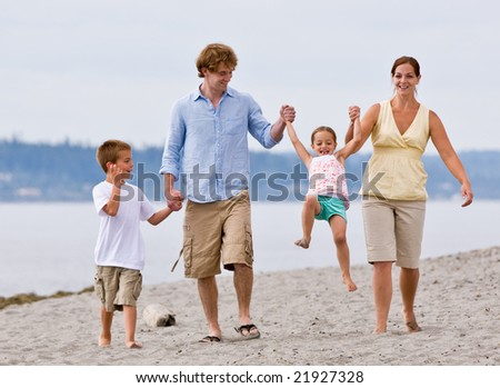 Family playing at beach - stock photo