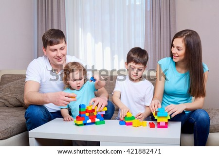 Family playing game together at home. - stock photo