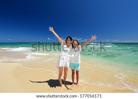 Family playing on the beach in Okinawa - stock photo