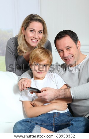 Family playing video game on smartphone - stock photo