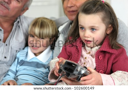 family playing video games - stock photo