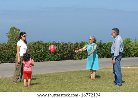 Family playing with a ball on a park