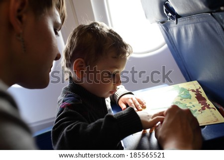 Family playing with a board game on a flight - stock photo