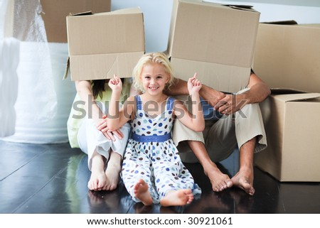 Family playing with boxes at home