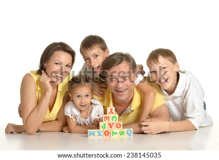 Family playing with cubes isolated on white