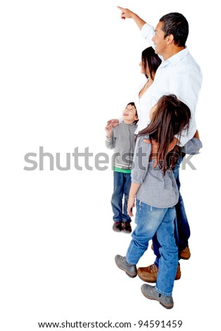 Family pointing at a blank space to edit - isolated over a white background - stock photo