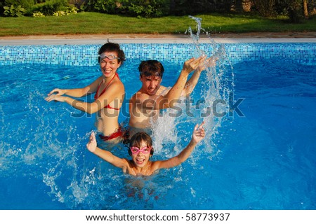 Family pool fun - stock photo