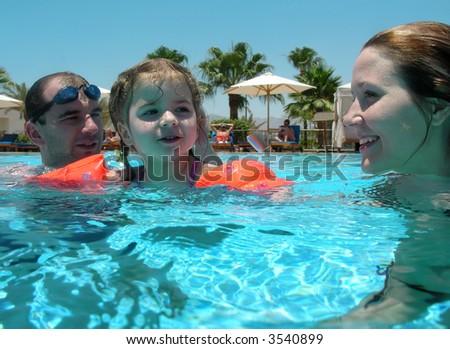 family pool swim - stock photo