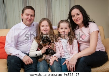 Family portrait at home - with two children and dog - stock photo
