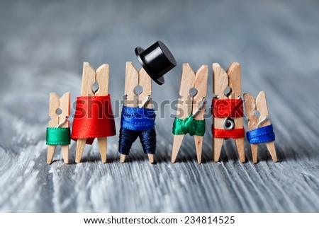Family portrait. Concept. Playground family. Abstract: The family of linen clothespins. Man, woman with child. Man, woman, child in swimwear. (Soft focus). - stock photo