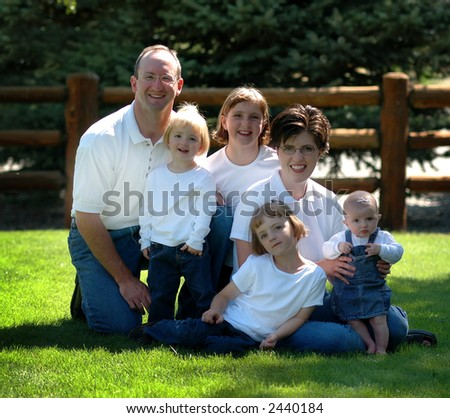 Family Portrait Dressed in White Shirts