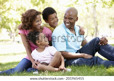 Family portrait in park - stock photo