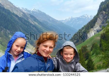 Family portrait in summer Alps mountain - stock photo
