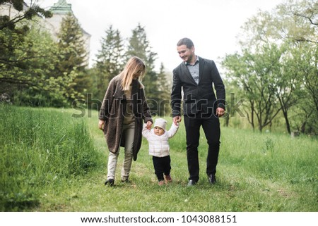 Family portrait in the park. Family with a child in the park. Rest of happy family in nature.