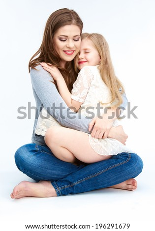 Family portrait. Mother hugging daughter. White background isolated.