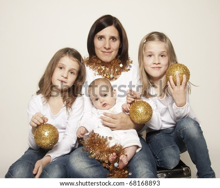 Family portrait - mother, twin girls and little baby boy - stock photo