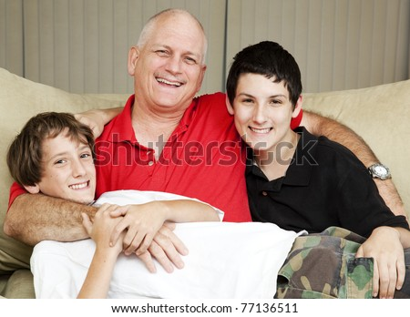 Family portrait of a loving father with his two sons. - stock photo