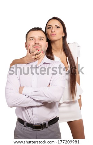 Family portrait of a modern young people. Man and woman wear a dress code. Complex family relationships. Woman dominates man. Love and hate each other simultaneously. Keep a man in his hands. - stock photo