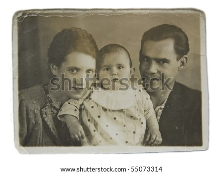 Family portrait of a young couple with a child, an old picture - stock photo