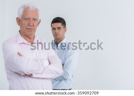 Family portrait of attractive father and son - stock photo