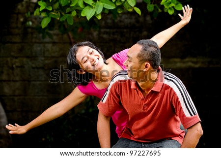 family portrait of cheerful asian ethnic young adult couple - stock photo