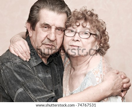 family portrait of great elderly people hugging - stock photo