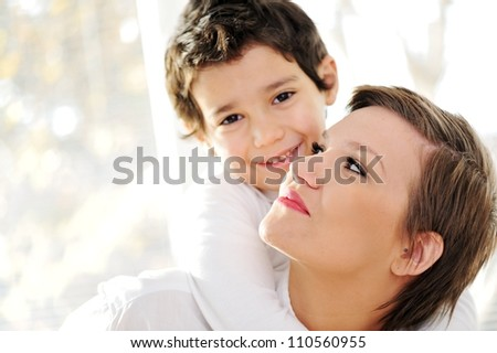 Family portrait of mother and son at home - stock photo