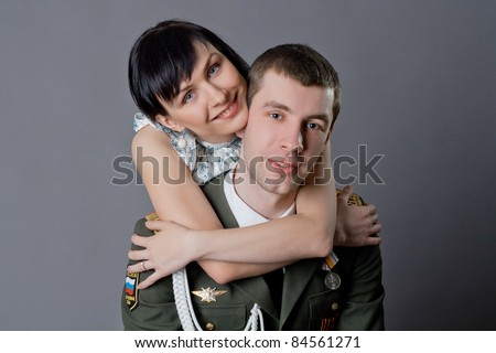 Family portrait of russian soldier and his girl - stock photo