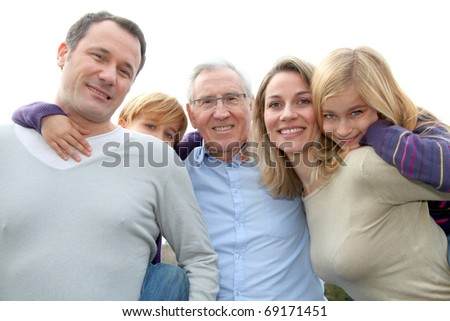 Family portrait standing outside - stock photo