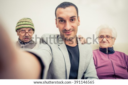 Family portrait with grandparents. selfie with smart phone - stock photo