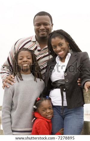 Family Portraits on the Beach - stock photo