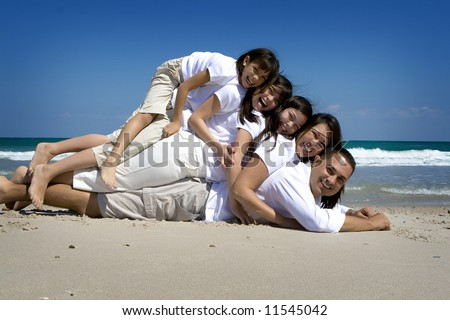 Family pose at the beach - stock photo