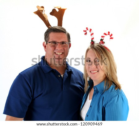 Family posing for Christmas photo wearing festive holiday hats - stock photo