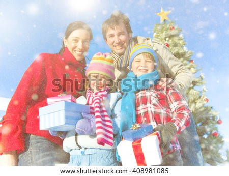 Family posing for outdoors christmas themed picture. - stock photo