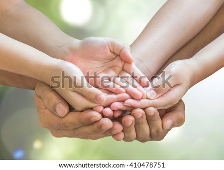 Family prayer hands in empty open palm gesture praying together on green natural bokeh background with clipping path: Father mother support daughter son spiritual pray for peace of mind CSR concept - stock photo