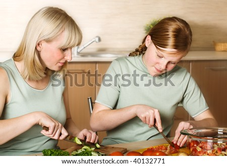 Family preparation of meal - stock photo