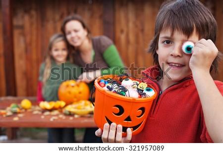 Family preparing for the halloween - carving pumpkin jack-o lanterns - stock photo