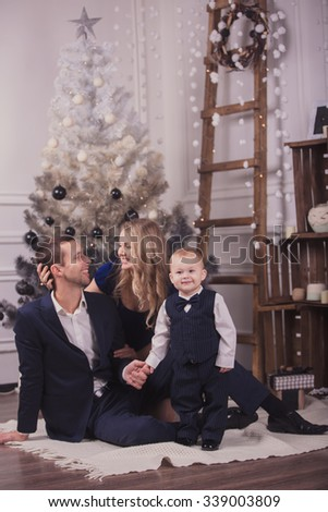 Family prepearing for christmas holidays at home - stock photo