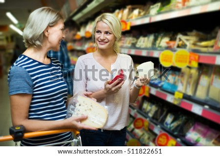 family purchasing  food in interior