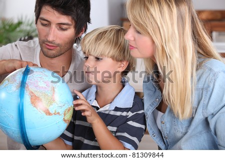 family, reading, globe - stock photo