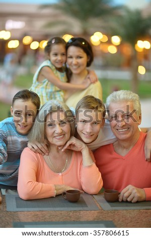 Family relaxing at resort - stock photo