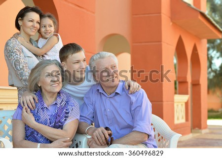 Family relaxing at vacation resort - stock photo