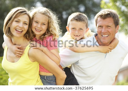 Family relaxing in countryside - stock photo