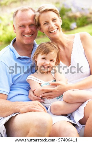 Family Relaxing In Garden - stock photo