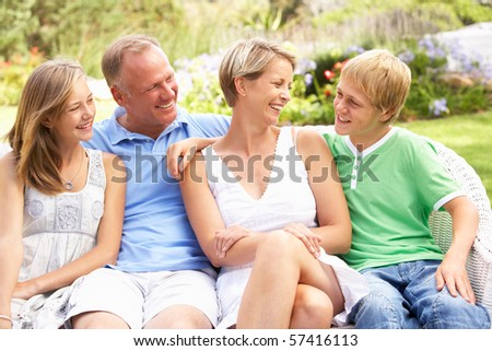 Family Relaxing In Garden