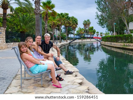 Family relaxing in tropics - stock photo