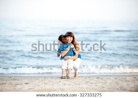 Family resting on the sea and have fun on a bright sunny day - stock photo