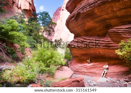 Family resting. Taylor  Creek trail  in Kolob canyons. Zion national park, Utah