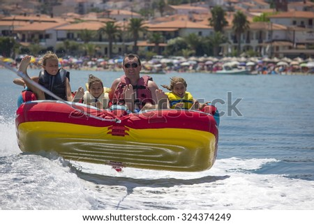 Family ride on the sea - stock photo