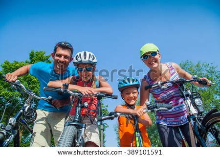 Family riding bikes - stock photo